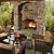 Outdoor stone fireplace serves as focal point for entertaining.